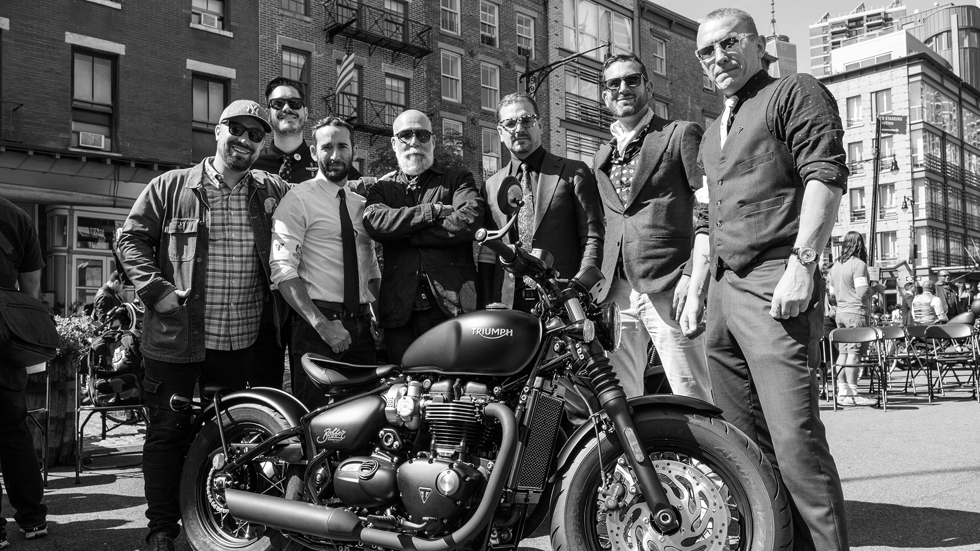 Distinguished gentlemen ready for their ride with Triumph in shot