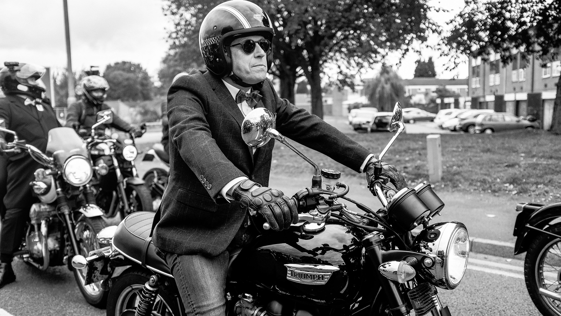 Triumph Rider taking in the experience of a Distinguished Gentlemen's Ride
