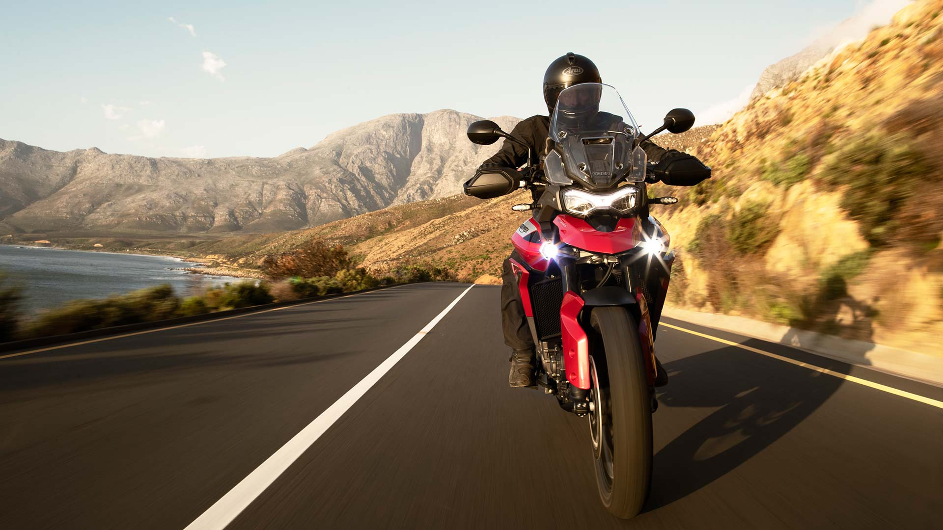 Triumph Tiger 900 GT Pro in Korosi Red powering down South Africa's roads