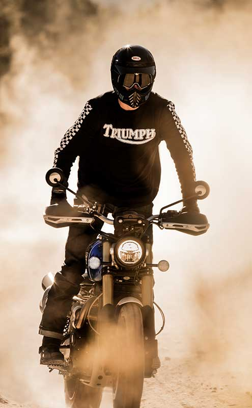man riding Triumph Scrambler 1200 through dirt