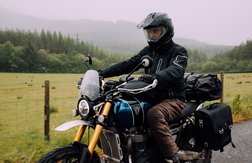 Triumph Scrambler 1200 adventure ready fitted with genuine Triumph accessories including fly screen, panniers, top box, tank bag and headlight grill