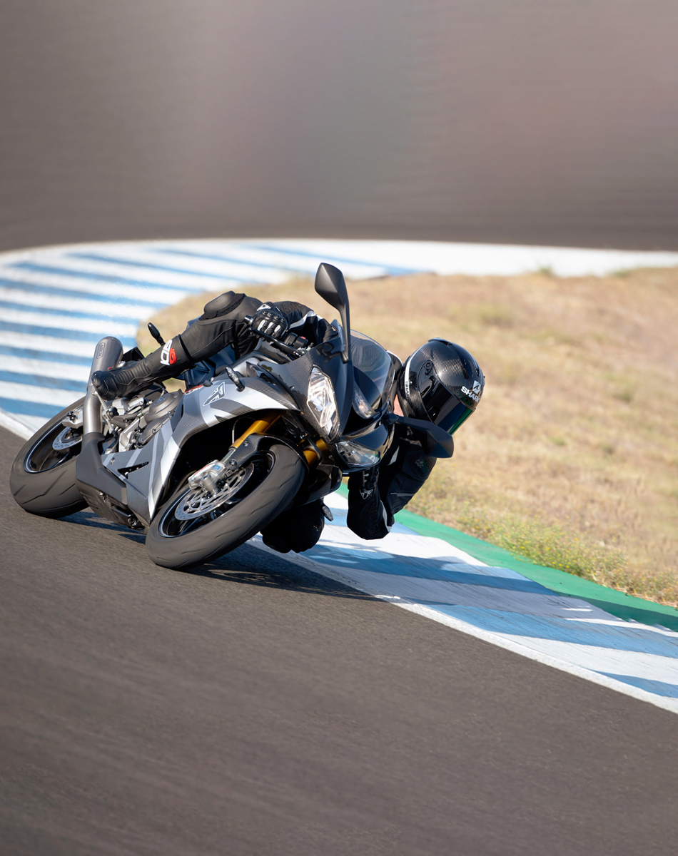 Triumph Daytona Moto2TM 765 motorcycle (EU and Asia Edition) racing around a track at speed