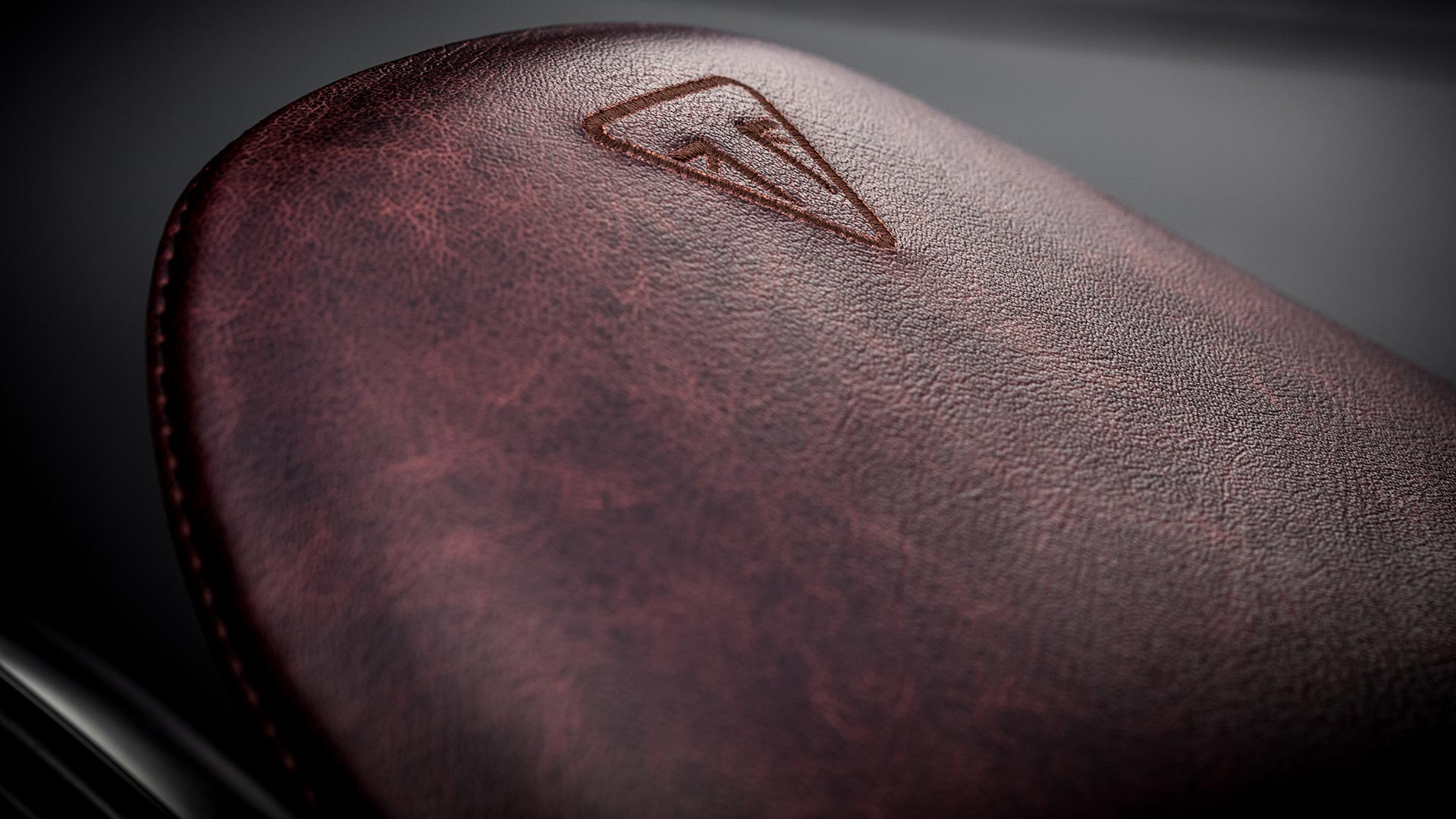 Close-up shot of the Triumph Bobber TFC's sculpted leather seat